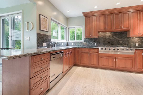 An expansive chef's kitchen with marble backsplash. Photo 7 of An Enchanting Nichols Canyon Hideaway With a Storied Bohemian Past modern home