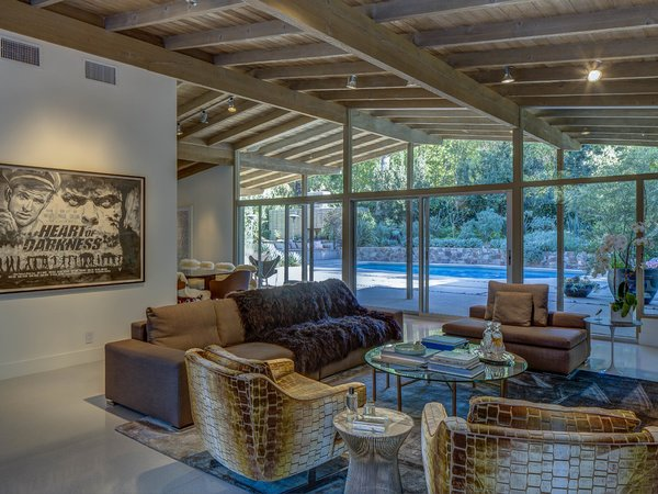 The home's walls of glass bring the swimming pool and attractive landscaping to the forefront of the living experience. Photo 7 of Midcentury Post and Beam In Fryman Canyon modern home