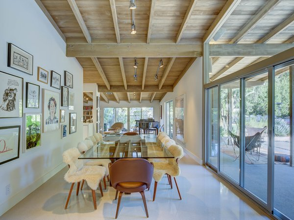 Terrazzo floors in the open dining room provide modernize the space Photo 9 of Midcentury Post and Beam In Fryman Canyon modern home