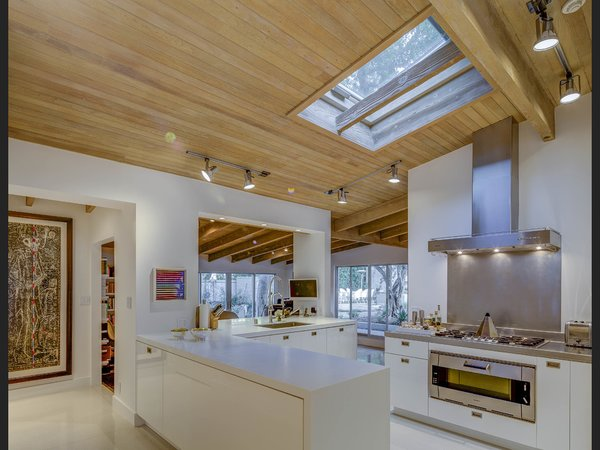 The open chef's kitchen feels like a natural extension of the home. Photo 11 of Midcentury Post and Beam In Fryman Canyon modern home