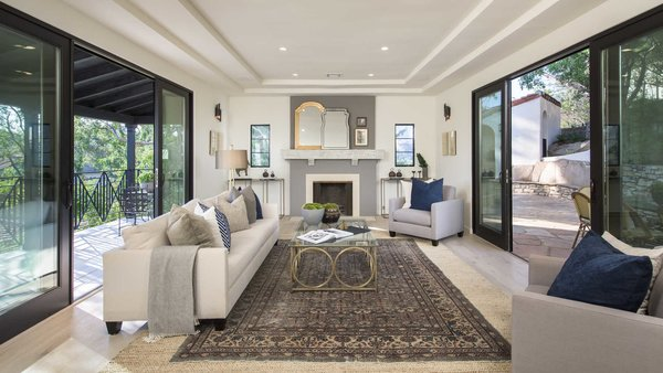 The home's original trey ceilings exude elegance, while sliding pocket doors create a seamless indoor-outdoor connection, leading to a spacious terrace and dining patio.