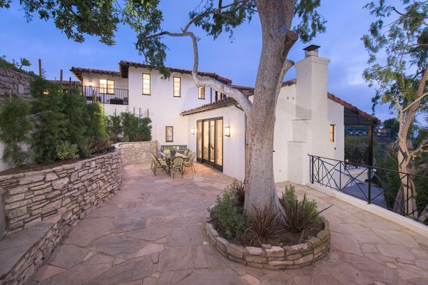 Modern home with outdoor, side yard, raised planters, trees, walkways, gardens, and stone patio, porch, deck. Photo 5 of A 1930s Spanish Colonial in Los Feliz Reimagined for the 21st Century