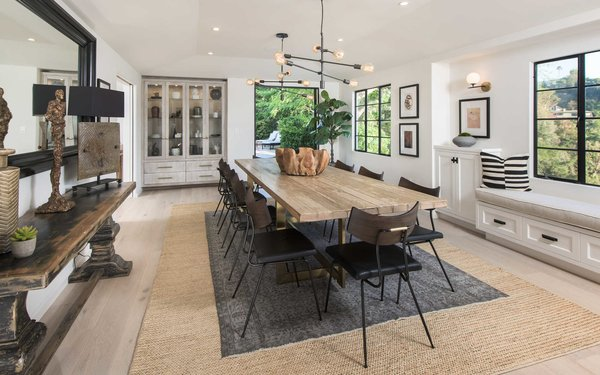 Modern home with dining room, table, chair, accent lighting, light hardwood floor, and recessed lighting. Contemporary fixtures and furnishings give the formal dining room a clean, contemporary appeal. Photo 7 of A 1930s Spanish Colonial in Los Feliz Reimagined for the 21st Century