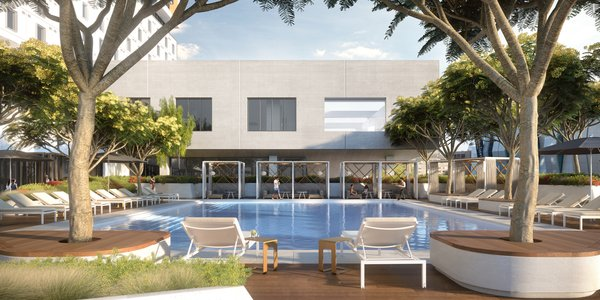 Modern home with outdoor and large pool. The outdoor pool features a sundeck, private, shaded daybeds, and indoor/outdoor lounge. Photo 7 of The Residences at The Sawyer
