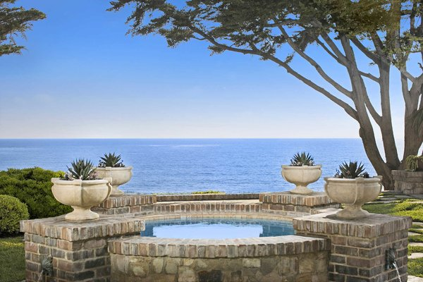 Modern home with outdoor, garden, trees, grass, back yard, gardens, and walkways. A tranquil water feature set against the sweeping coastline Photo 8 of A Monumental Oceanfront Estate on the California Coast