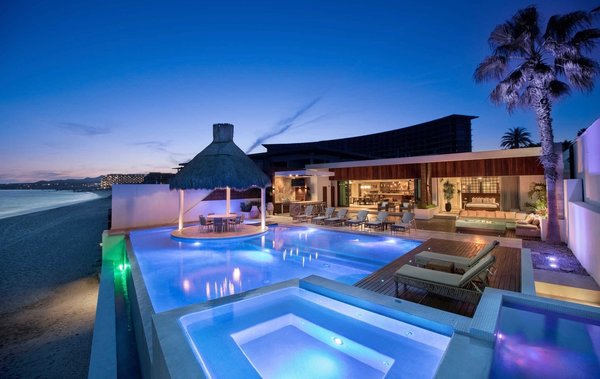 Modern home with outdoor, large patio, porch, deck, swimming pool, and salt water pool. The oceanfront pool terrace at the recently remodeled Villa Serena.  Photo  of A Contemporary Makeover Transforms Oceanfront Villa Serena