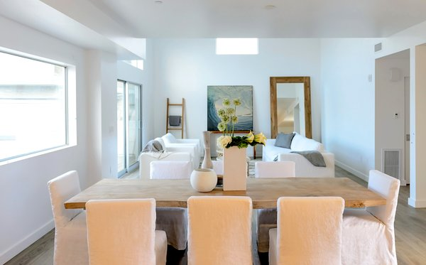 Modern home with dining room. The dining room captures light from multiple directions. Photo  of It's All About The Light at AIRE Santa Monica
