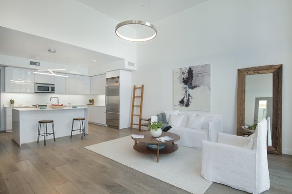 Modern home with living room. The bright, white great room features gallery walls and soaring ceilings.  Photo 2 of It's All About The Light at AIRE Santa Monica