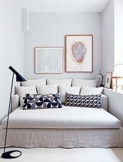 10 Effective Tips For Making the Most Out of Small Space Interiors - Photo 3 of 10 -  Pairing patterned throw pillows with a neutral sofa creates a soothing palette in a tight space.
