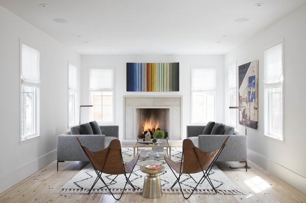 Deliberately create a focal point in your space. Keep in mind that a little symmetry never hurts.