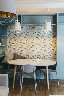 Chairs with clean lines in a signature hue add punch to small breakfast nook.