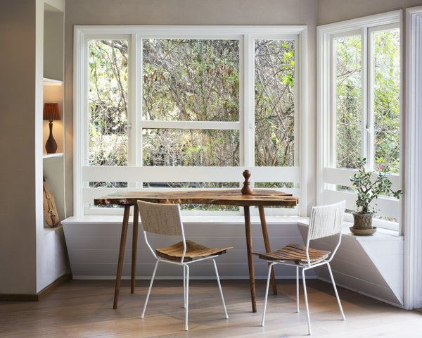 5 Main Ingredients For Cooking Up a Homey Kitchen Nook - Photo 8 of 8 - A beautifully simple shiplap built-in banquette balances perfectly with a live edge table, making the most of the abundant natural light.