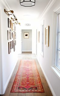 8 Essential Elements of California Style - Photo 3 of 10 - A beautiful and bold vintage runner adds color and pattern to create a dynamic hallway.