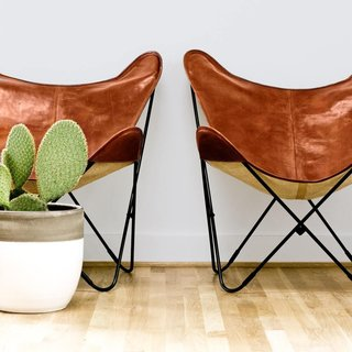 8 Essential Elements of California Style - Photo 7 of 10 - Simple butterfly chairs paired with a cactus.