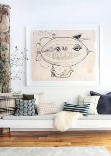 8 Essential Elements of California Style - Photo 8 of 10 - Quirky, oversized artwork paired with pretty pillows—always a win in our book.