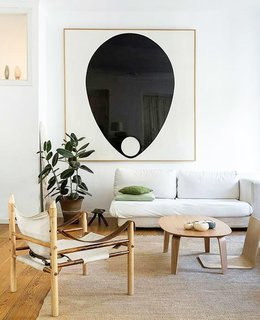 8 Essential Elements of California Style - Photo 9 of 10 - Graphic black and white artwork punctuates the bright, neutral space.