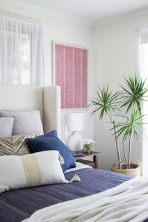 8 Essential Elements of California Style - Photo 10 of 10 - Layered throw pillows add color, texture and subtle pattern.
