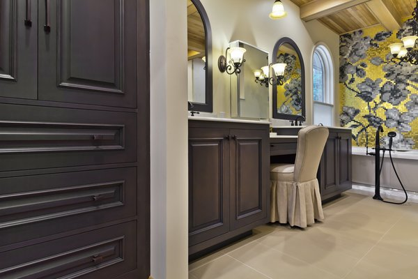 Wood-Mode linen cabinet and matching Wood-Mode vanities with custom mirror frames Photo 2 of Tuscan Retreat modern home