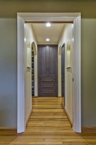 cypress flooring, custom built-in Wood-Mode linen cabinet Photo  of Tuscan Retreat modern home