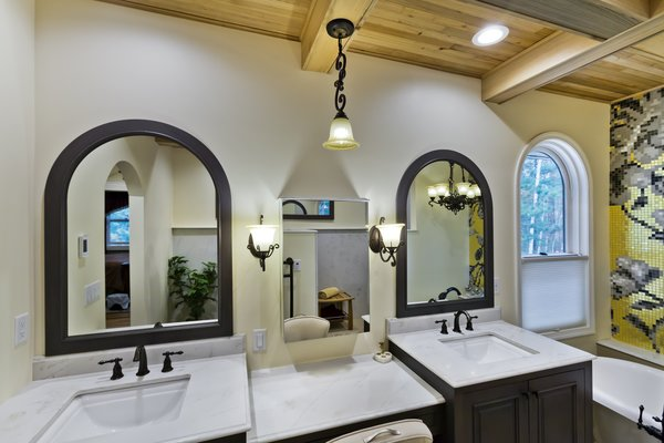 his & hers vanities with makeup station in between Photo 11 of Tuscan Retreat modern home