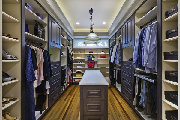 Wood-Mode custom closet system Photo 18 of Tuscan Retreat modern home