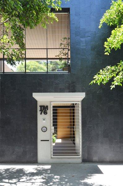 Modern home with doors, exterior, metal, and swing door type. Pedestrian Entry Photo  of Casa CorManca