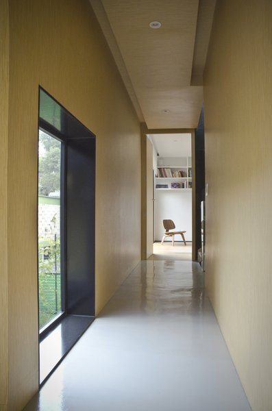 Modern home with hallway and light hardwood floor. Interior to the Family Room Photo 10 of Casa CorManca