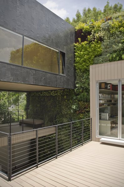Modern home with outdoor, gardens, small patio, porch, deck, and wire fence. Main Terrace Photo 11 of Casa CorManca