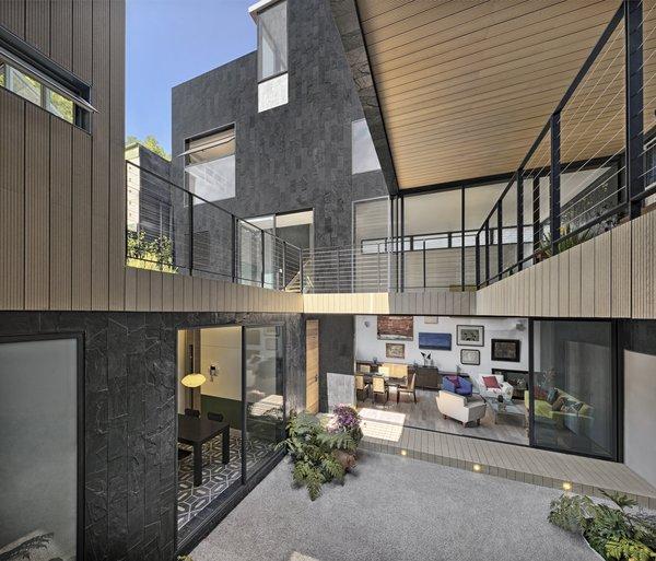 Modern home with outdoor, small patio, porch, deck, and back yard. Interior Pario Photo 3 of Casa CorManca