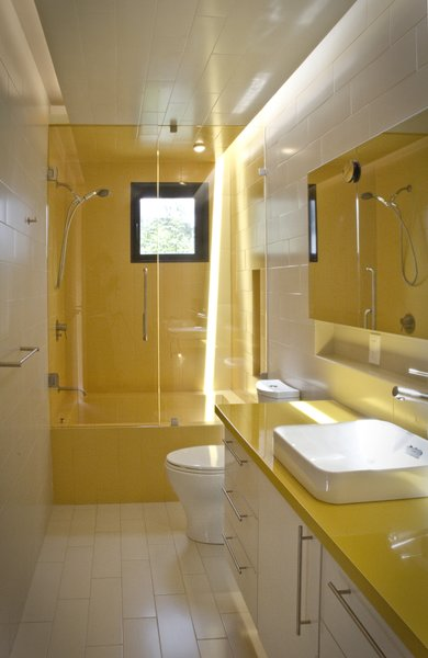 Modern home with bath room, tile counter, soaking tub, ceramic tile floor, drop in sink, full shower, recessed lighting, ceramic tile wall, and one piece toilet. Kid´s Bathroom Photo 8 of Casa CorManca