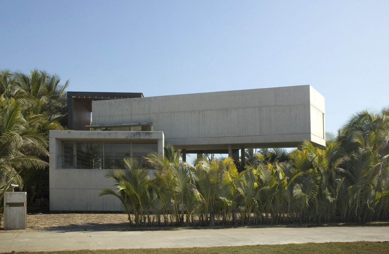 Pedestrian and Car Main Entry Tagged: Garage. La Caracola Beach House by PAUL CREMOUX studio