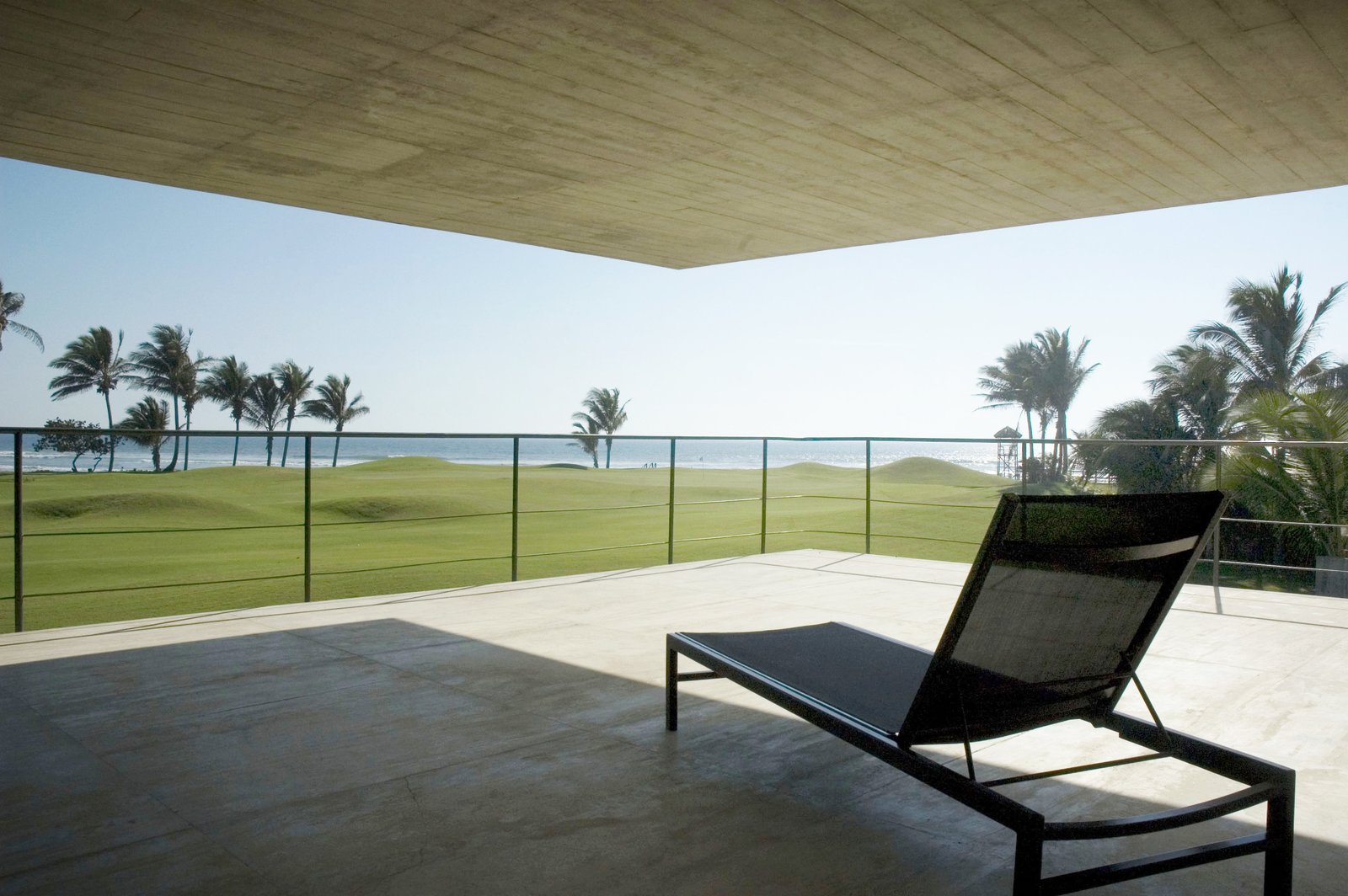 Terrace Level 2 Tagged: Outdoor, Stone Patio, Porch, Deck, and Field.  La Caracola Beach House by PAUL CREMOUX studio