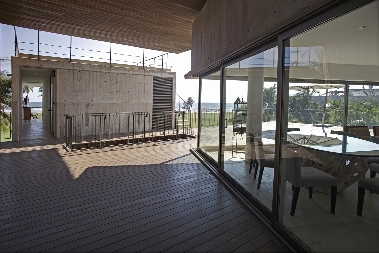 Terrace Level 3, Dinning-Living and Entry to the Master Bedroom Tagged: Outdoor, Wood Patio, Porch, Deck, and Field.  La Caracola Beach House by PAUL CREMOUX studio