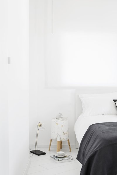 View of white minimalist Bedroom  Photo 13 of White Space in the White City modern home