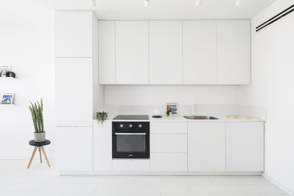 View of the Kitchen Photo 2 of White Space in the White City modern home