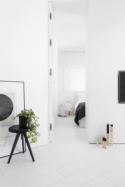 View of white minimalist Bedroom  Photo 11 of White Space in the White City modern home