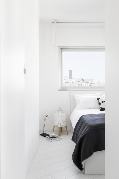 View of white minimalist Bedroom  Photo 12 of White Space in the White City modern home