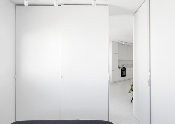 View from the bedroom to the kitchen Photo 14 of White Space in the White City modern home