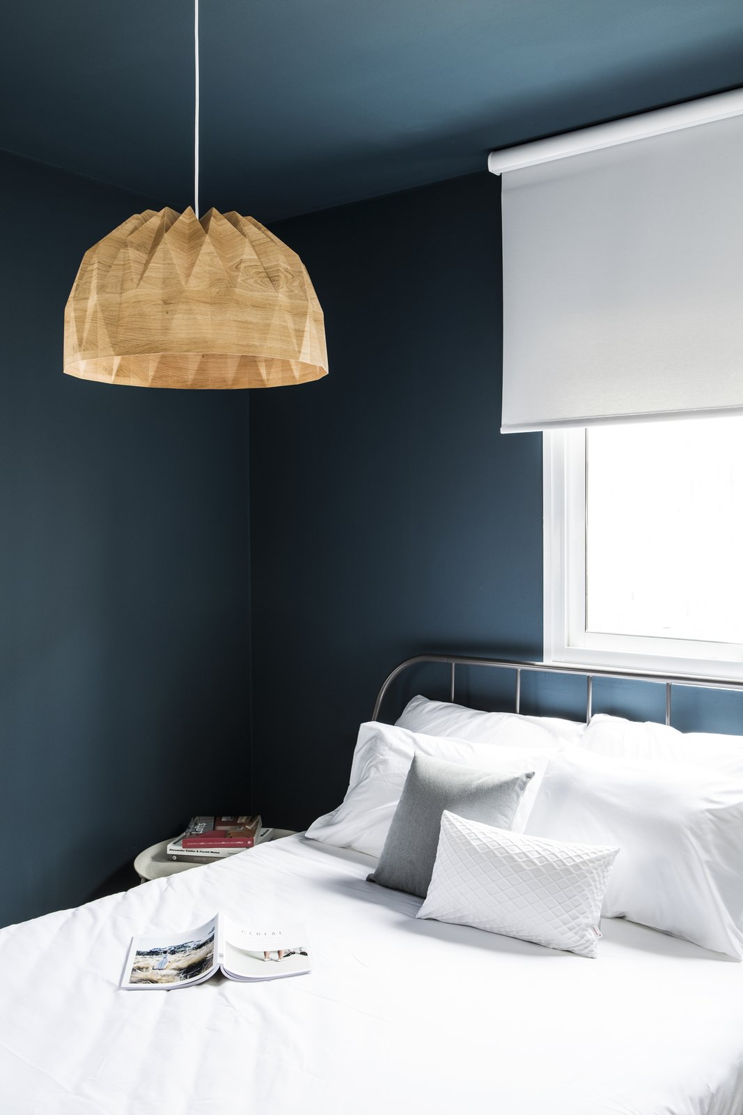 Master Guest Suite  Tagged: Bedroom, Bed, Dresser, Wardrobe, Night Stands, Bench, Shelves, Bunks, Storage, Chair, Ceiling, Table, Light Hardwood, and Bookcase.  Best Bedroom Storage Ceiling Photos from A A Duplex