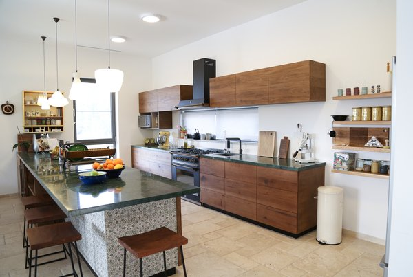 Modern home with kitchen, limestone floor, wood cabinet, marble counter, ceiling lighting, and ceramic tile backsplashe. The kitchen Photo 14 of A house in the mountains