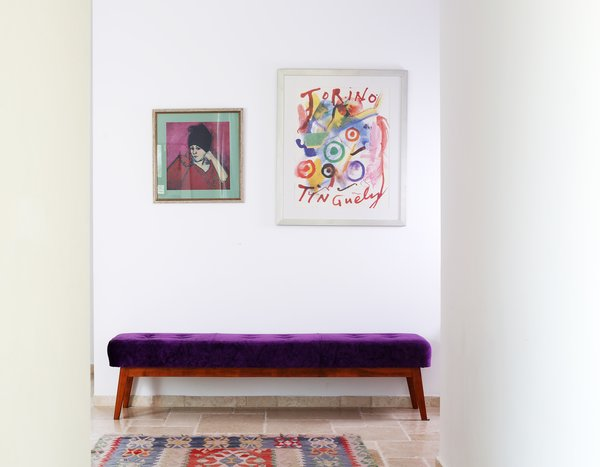 Modern home with living room, bench, and travertine floor. Purple bench at the entrance to the house Photo 20 of A house in the mountains
