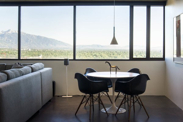 Modern home with dining room, table, chair, pendant lighting, and concrete floor. breakfast table looking at the wasatch mountain range Photo 3 of Governors Plaza