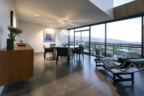 Modern home with dining room, table, pendant lighting, chair, storage, recessed lighting, and concrete floor. dining room - looking out to wasatch mountains Photo 7 of Governors Plaza