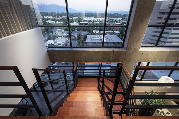 Modern home with staircase, wood tread, and metal railing. staircase - looking to salt lake valley beyond Photo 11 of Governors Plaza
