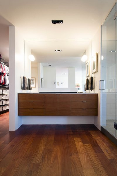 Modern home with marble counter, vessel sink, enclosed shower, wall lighting, medium hardwood floor, recessed lighting, and bath room. master bathroom - vanity featuring crisp sconces by rich, brilliant, and willing Photo 15 of Governors Plaza