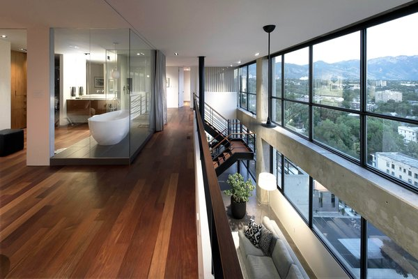 Modern home with marble counter, recessed lighting, hallway, and light hardwood floor. mezzanine - looking toward master bathroom and living below Photo 16 of Governors Plaza