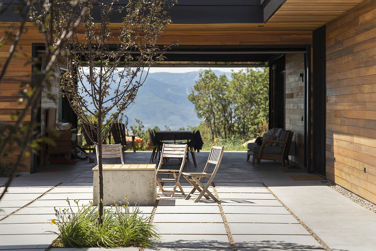 When it's retractable glass wall are open, the all-season room becomes a breezeway from the courtyard to the view of the mountains beyond. Tagged: Outdoor, Side Yard, Trees, Shrubs, Grass, Hardscapes, Walkways, Large, Concrete, Pavers, and Planters.  Best Outdoor Pavers Grass Photos from Red Hawk