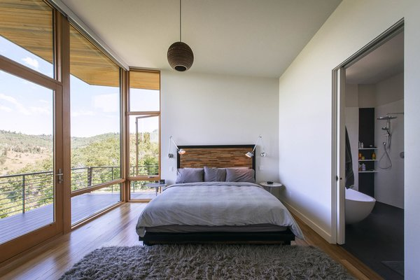 Placed on the north side of the home, the master bedroom is secluded and quiet with its own unique view of the canyon below.