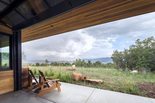 With operable, overhead glass walls the all-season room is the perfect place to watch summer and winter storms roll by.