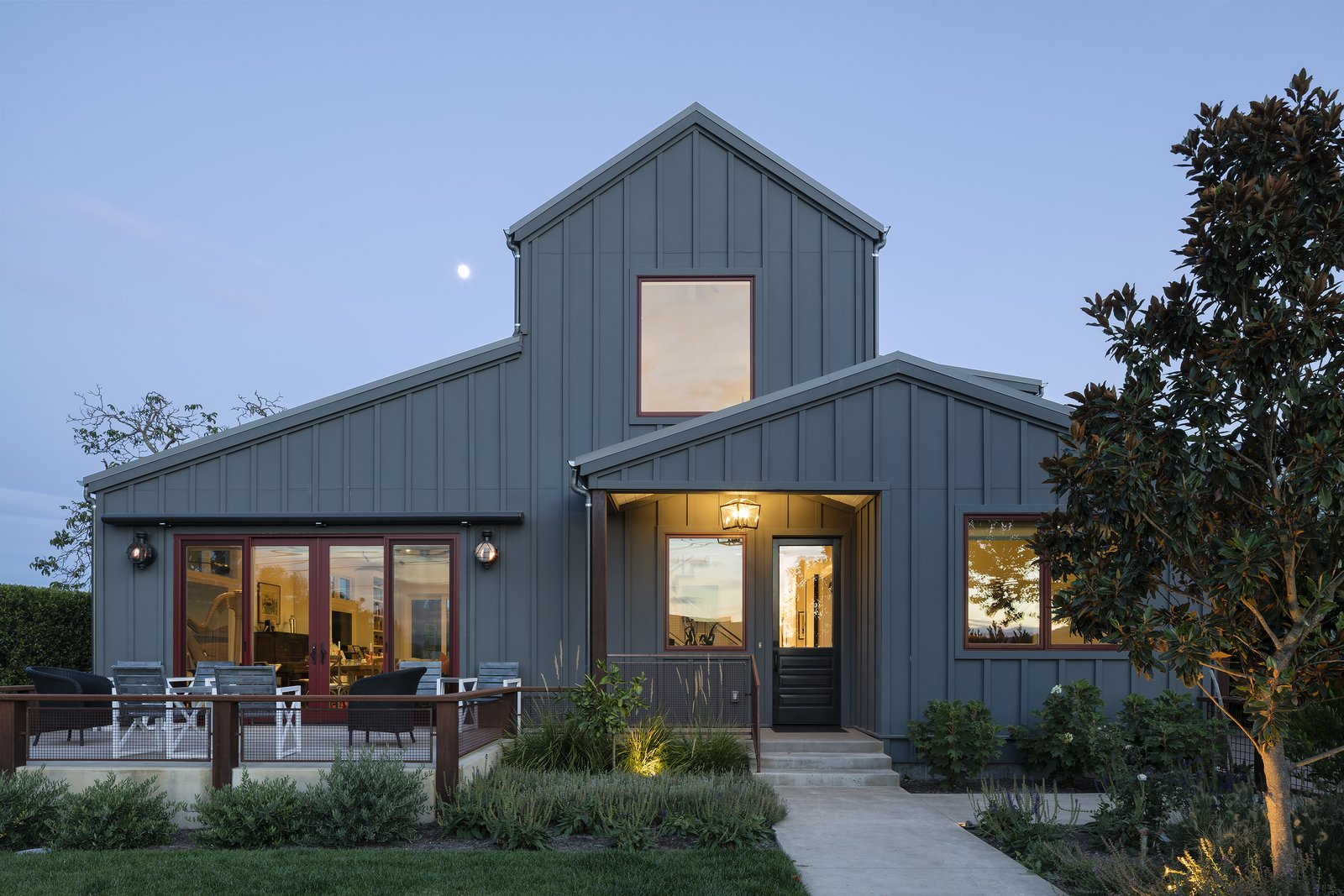 This contemporary farmhouse was designed for a client that loves to cook and entertain in the open air.   Photo 6 of 9 in 8 Modern American Farmhouses from Modern Farmhouse II